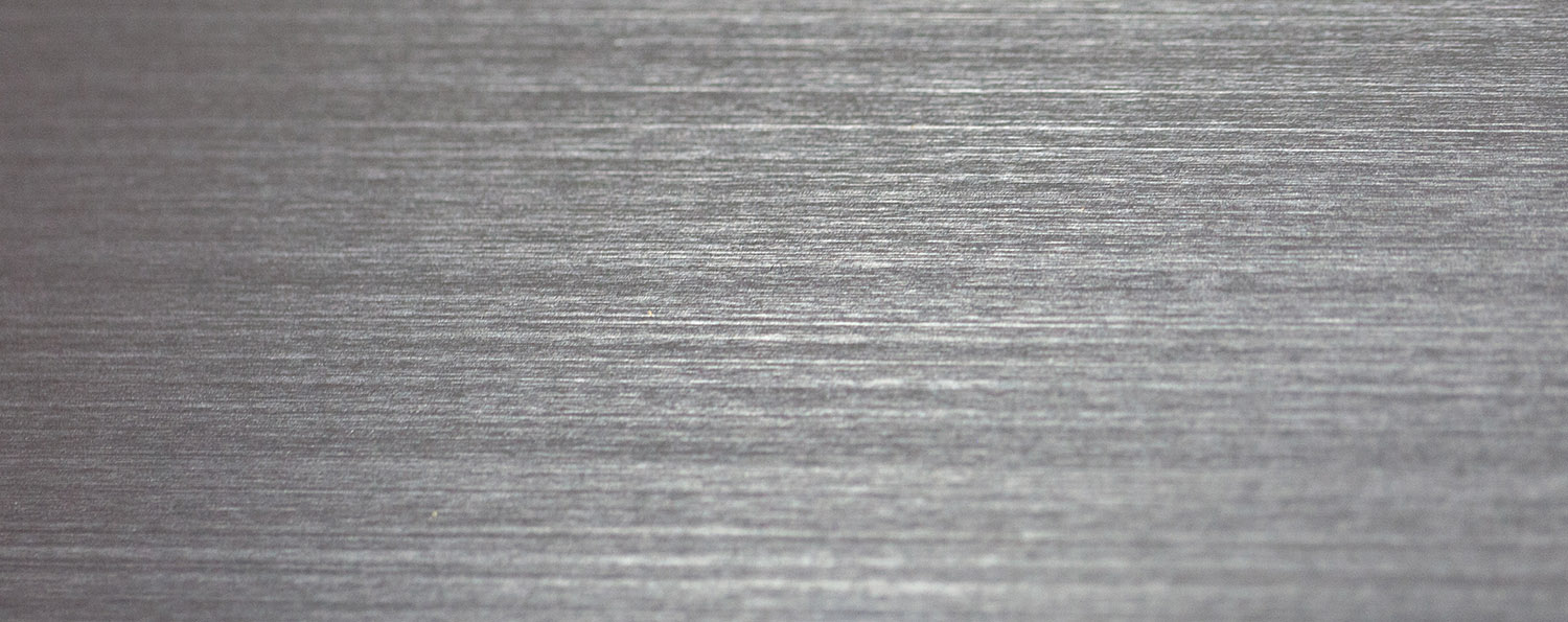 closeup of linear grains on metal surface