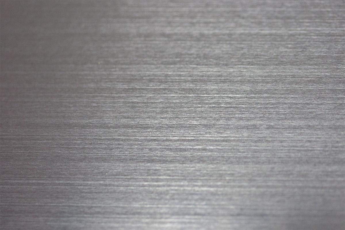 closeup of line graining in aluminum surface